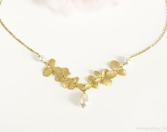 Gold orchid necklace Pearl bridal necklace Swarovski white pearl flower necklace Orchid wedding bridal floral dainty delicate gold necklace