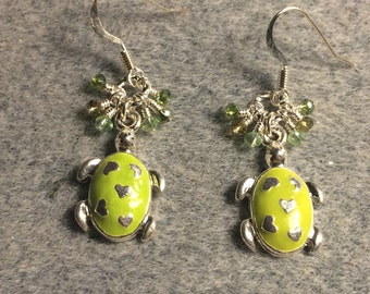 Lime green enamel turtle charm earrings adorned with tiny dangling lime green Chinese crystal beads.