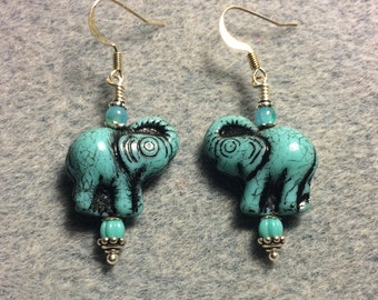 Turquoise and black Czech glass elephant bead dangle earrings adorned with turquoise Czech glass beads.