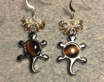 Silver with brown fiber optic stone turtle charm earrings adorned with tiny dangling brown and amber Chinese crystal beads.