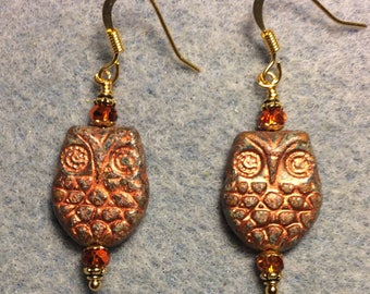Brown and orange with copper wash Czech glass owl bead earrings adorned with sparkly orange Chinese crystal beads.
