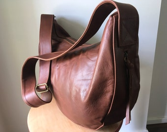 Curved, soft and slouchy handmade leather handbag.Crossbody wide strap, cotton lined. Leather handbag tote bag,excellent diaper or baby bag