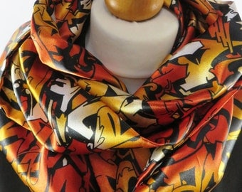 Graffiti graffiti!! A truly funky silky print infinity scarf with a graffiti design. Knock out colours. Limited edition made in the UK.