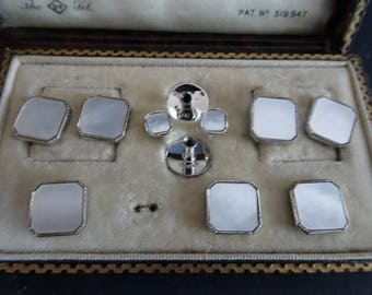 Vintage silver and mother of pearl cufflink and button set. Cased. Set on silver