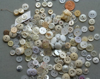 A Colection of White Vintage Buttons
