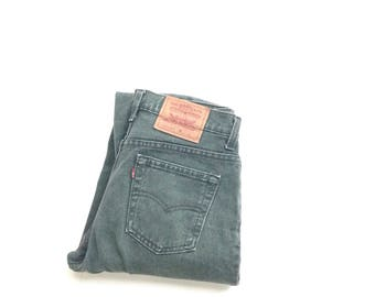 mom jeans. W28 L31. 80's Levis jeans, faded forest green, high waisted, tapered leg, relaxed fit cotton jeans. Made in USA.