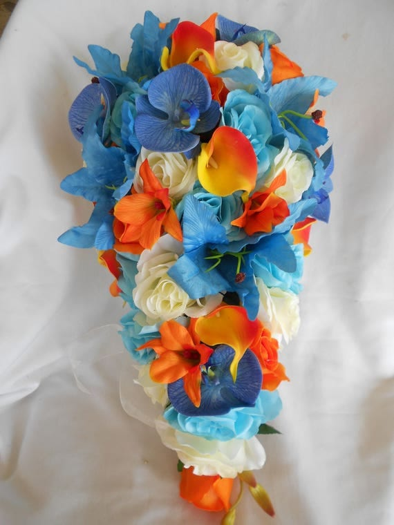 Cascade Malibu,,  turquoise  blue ivory  roses and tangerine orange Orchids  and calla lilies  2 pieces groom bout includes
