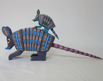 charming armadillo and baby alebrije