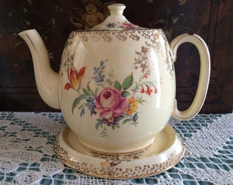 Royal Winton Grimwades Teapot and Matching Stand/Trivet/Tile. Cream with Pretty Floral Pattern.  Gold Detailing. Made in England in the 50s