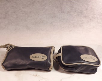 Two Delta Airlines gift leather toiletry travel cases