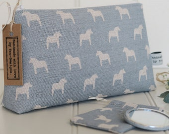 Make up bag in Olive & Daisy, Swedish Horses in Powder Blue Blotch Linen.