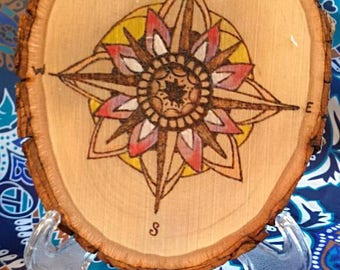 Wood burned compass rose