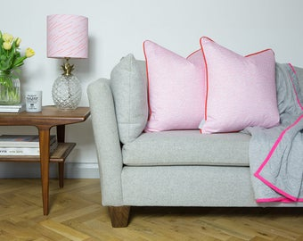 Brand cushion in Pink