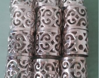 A Vintage 1950's Set Of 12 Silver Plated Scroll Napkin Rings