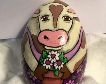 Brown and white cow holding flowers hand painted wood egg