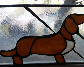Brown, white and clear stained glass dachshund.