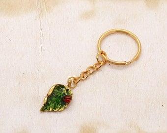 Enamel Ladybird Ladybug On Green Leaf Gold Coloured Keyring