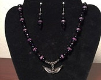 Black Glass Beads with Purple Accents and Angel Wings