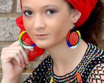 African round red centered earrings