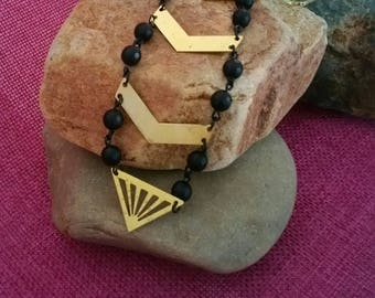 Long Gold Chevron necklace with faceted black matte onyx beads on a beautiful unique gold chain