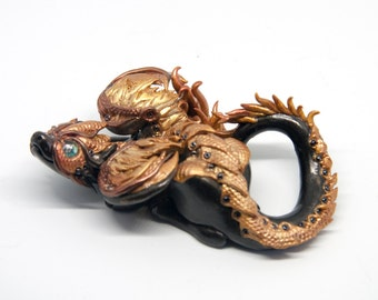Steampunk black and gold dragon figurine