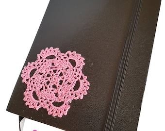 Black notebook with pink crochet decoration
