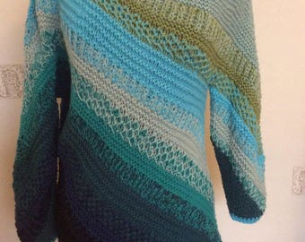 Combination of different patterns makes gorgeous this hand knitted off-shoulder long oversized  pullover