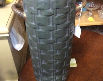 Tall ceramic vase with handles