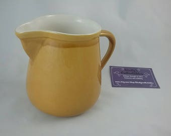 Honiton pottery jug. Chunky good sized pottery pitcher jug. White and dark yellow glaze. Devon. Country kitchen.