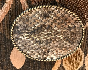 Genuine Diamondback rattle snake belt buckle.
