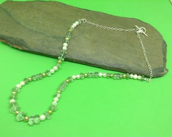 A green amethyst and freshwater cultured pearl necklace.
