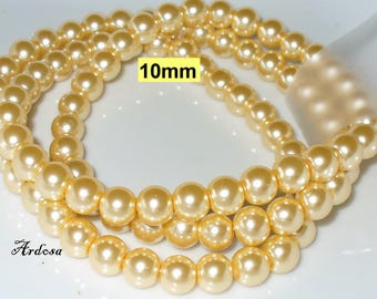1 strand 82cm = 86 glass pearls peach 10 mm (810.34.1)