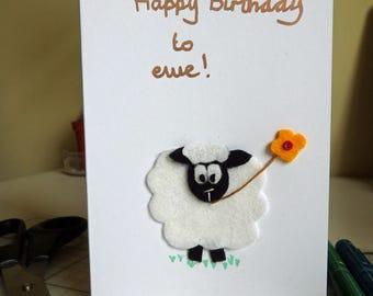 Birthday card, sheep with flower.