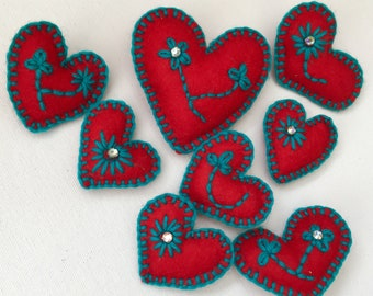 Handmade felt heart brooches with diamanté detail.