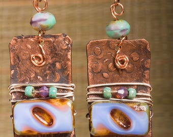 Textured copper earrings wrapped with silver wire and purple glass beads