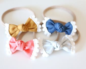 Pom pom trim bows/ cute baby bows/ baby headbands/ newborn headbands/ nylon headbands/ little baby bows/ cute baby headbands/ trendy bows