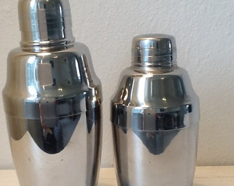 two vintage cocktail shakers