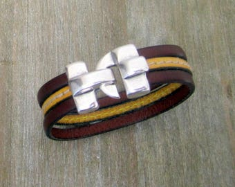 Man leather brown/yellow with Couture, silver clasp bracelet