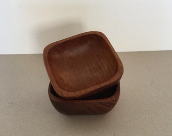 Mid century set from two small teak bowls
