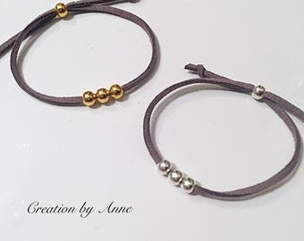 Bracelets gold or silver plate with way suede adjustable string.