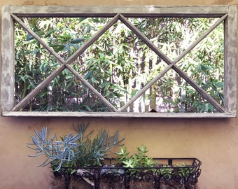 Really cool old window with mirrors in place of glass