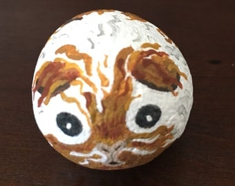 Stylized painted guinea pig stone