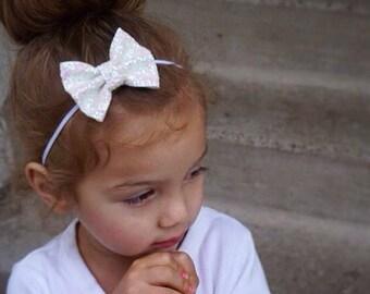 White chunky glitter bow on an alligator clip OR skinny elastic headband
