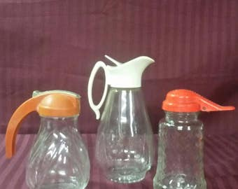 Vintage syrup pitchers  buyer's choice.  3 available