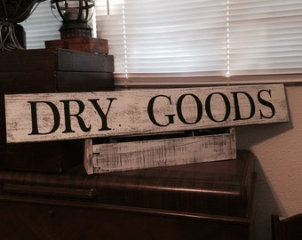 Wooden rustic Dry Goods sign on reclaimed wood