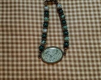 Green Riverstone, Green Agate gemstones, antique brass, cobochon, picture