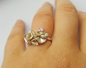 Beautifully contemporary silver ring with pink cubic zirconia