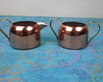 Vintage copper creamer and sugar set.