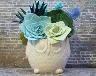 Felt succulent arrangement in a white owl ceramic container