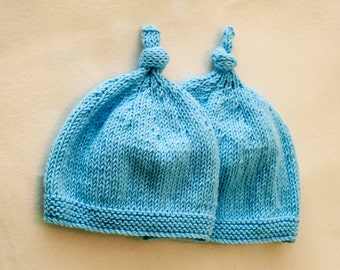 Blue hand knitted baby hat